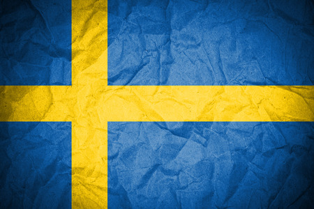 Sweden flag painted on crumpled paper  photo