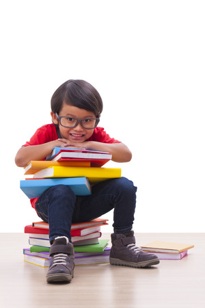 Happy boy sit and holding books  photo