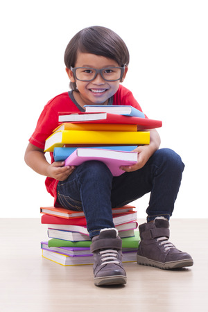 Cute boy sit and holding books  photo