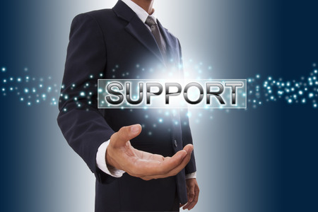 Businessman hand showing support button on virtual screen.