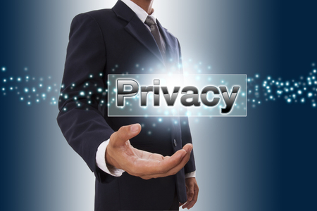Businessman hand showing privacy button on virtual screen. photo