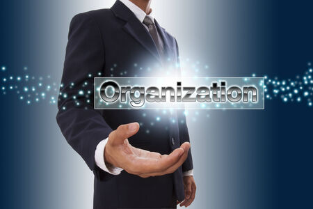 Businessman hand showing organization button on virtual screen photo