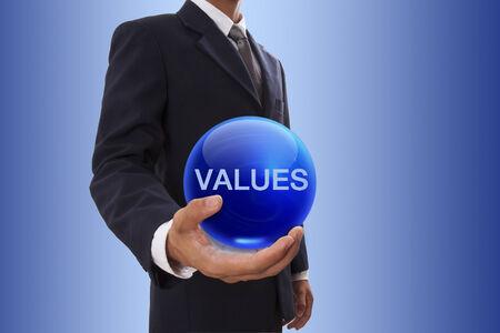 Businessman hand holding blue crystal ball with values word. Reklamní fotografie