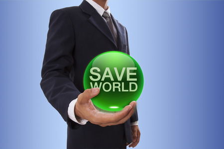 Businessman hand holding green crystal ball with save world word. photo