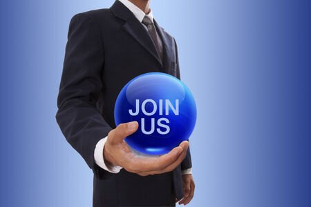 Businessman hand holding blue crystal ball with join us word. photo