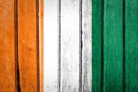 Ivory Coast Flag on old wood texture Stock Photo