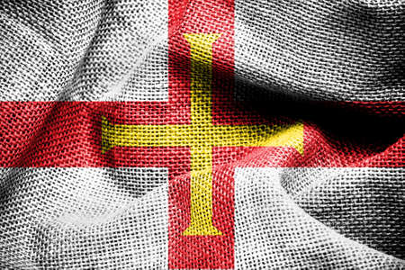 Texture of sackcloth with the image of the Guernsey flag
