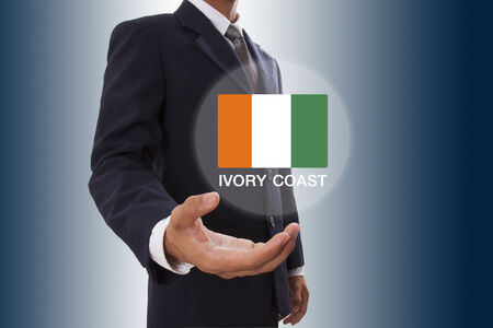 isolation backdrop: Businessman hand showing Ivory Coast flag Stock Photo