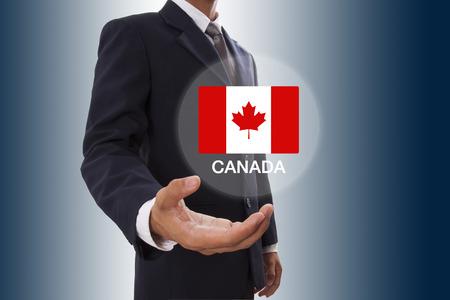 canada flag: Businessman hand showing Canada Flag