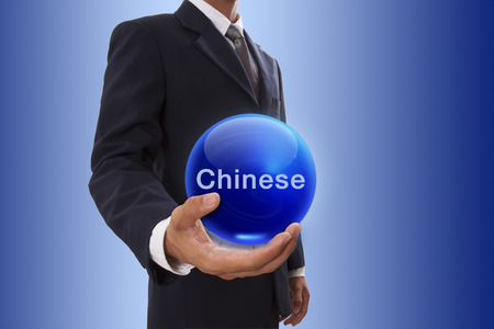 ability to speak: Businessman hand holding blue crystal ball with chinese word.