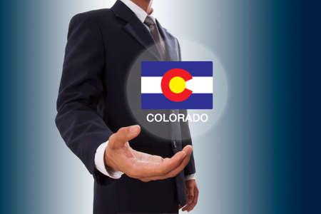 colorado flag: Businessman hand showing Colorado Flag