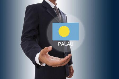 palau: Businessman hand showing Palau Flag