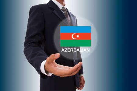 Businessman hand showing Azerbaijan Flag photo