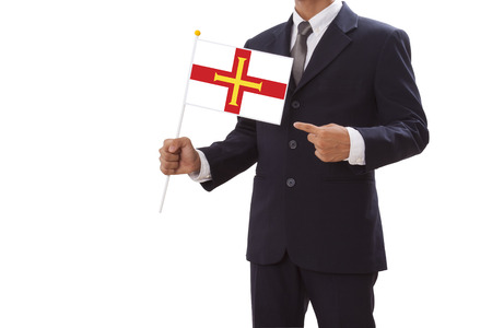 legitimate: Businessman in suit holding Guernsey Flag