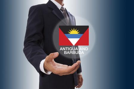 antigua flag: Businessman hand showing Antigua and Barbuda Flag