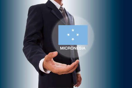 micronesia: Businessman hand showing Micronesia Flag