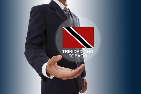 tobago: Businessman hand showing Trinidad and Tobago Flag