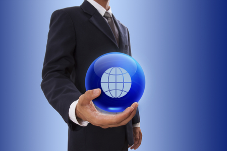 Businessman hand holding blue crystal ball with global icon. photo