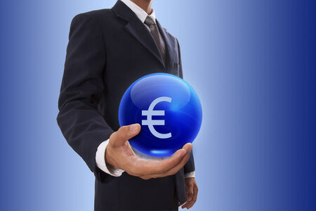 Businessman hand holding blue crystal ball with euro sign. photo