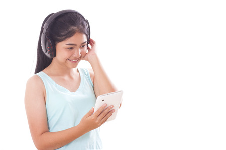 Young women with tablet pc and headphones. photo