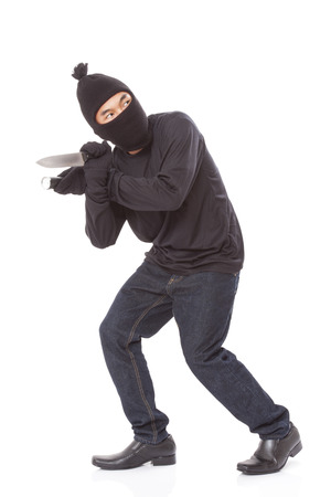 scoundrel: Man in a mask holding flashlight with a knife on a white background