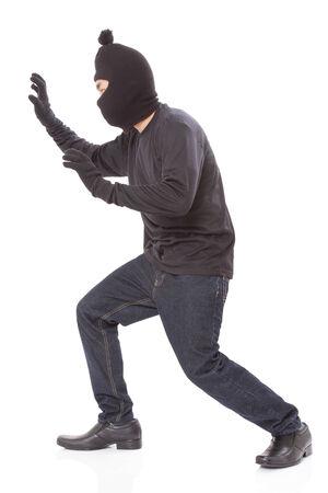 scoundrel: L'uomo indossa maschera su su sfondo bianco Archivio Fotografico