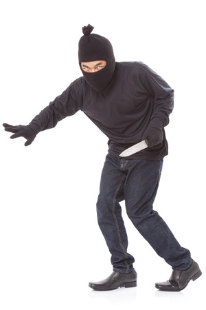 Man in a mask with a knife on a white background Stock Photo