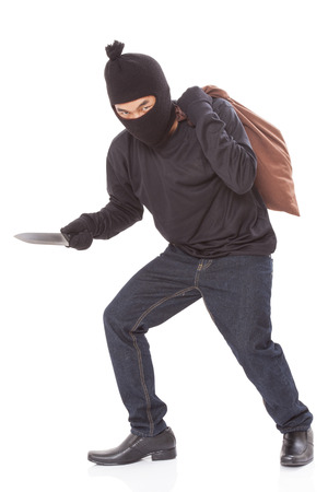 Thief with bag and holding knife, isolated on white background Stock Photo