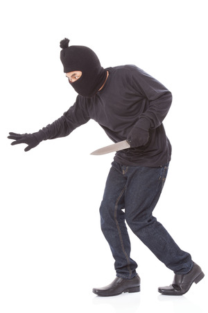 scoundrel: Man in a mask with a knife on a white background Stock Photo