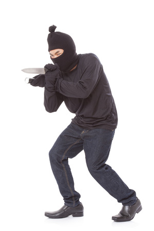 ruffian: Man in a mask holding flashlight with a knife on a white background