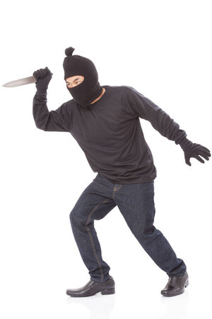 thievery: Man in a mask with a knife on a white background Stock Photo