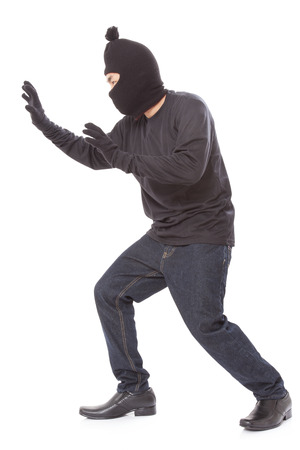 thievery: Man wearing mask on over white background Stock Photo