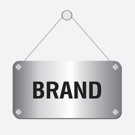 branded product: silver metallic brand sign hanging on the wall