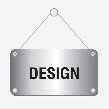 silver metallic design sign hanging on the wall