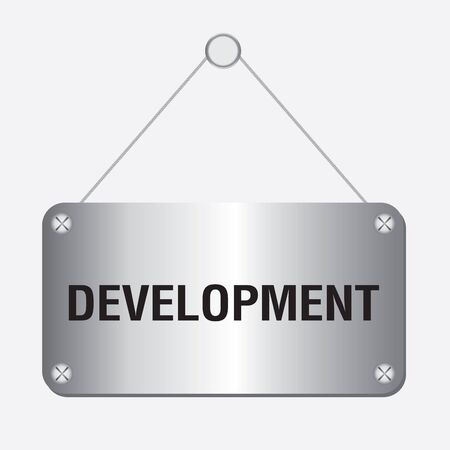 economic development: silver metallic development sign hanging on the wall
