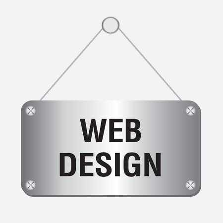 silver metallic web design sign hanging on the wall