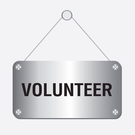 volunteering: silver metallic volunteer sign hanging on the wall