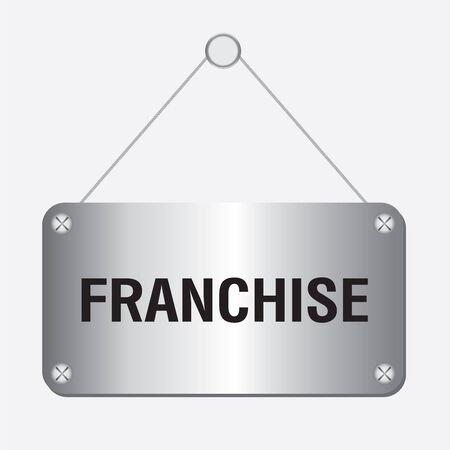 distribute: silver metallic franchise sign hanging on the wall