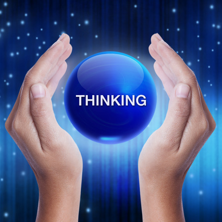 cogitate: Hand showing blue crystal ball with thinking word. business concept