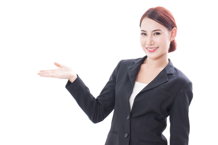 copyspase: Smiling young businesswoman showing blank area for sign or copyspase, isolated over white background