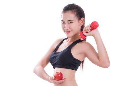 levantando pesas: Mujer del deporte que hace ejercicio con levantamiento de pesas Foto de archivo