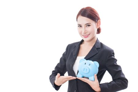 Happy young business woman holding piggy bank isolated on white background