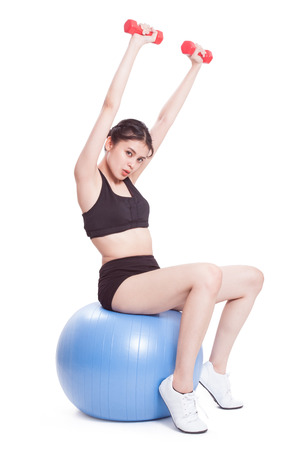 ball: Fitness woman sport training with exercise ball and lifting weights