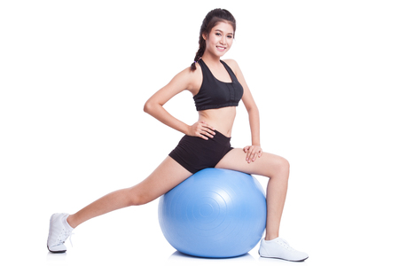 ball stretching: Sport woman doing stretching fitness exercise on ball