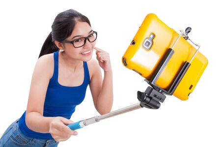 stick: Happy woman taking picture with smartphone selfie stick