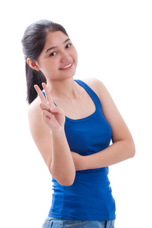 two persons only: Happy smiling young woman showing two fingers or victory gesture Stock Photo