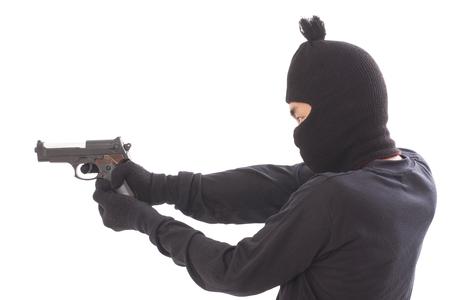 desperado: man in a mask with a gun on a white background