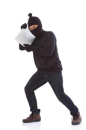 furtive: Thief stealing a laptop computer