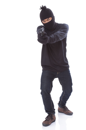 kidnapper: man in a mask with a gun on a white background