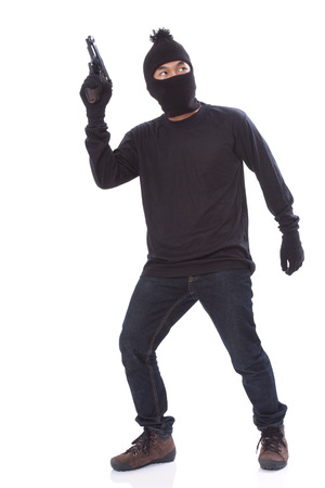 blackmail: man in a mask with a gun on a white background